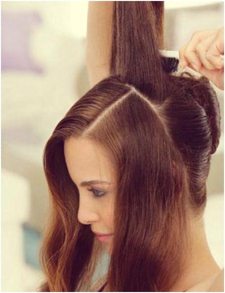 Начесать верхнюю часть волос, расположенную ближе к затылочной части