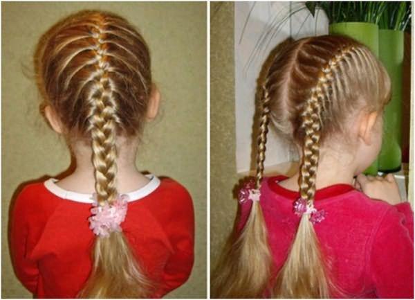 На фото: косички на голове маленькой девочки
