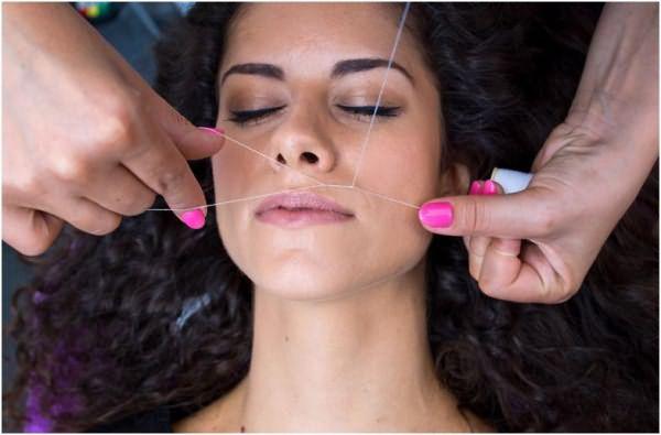 Удаление волосков на лице ниткой