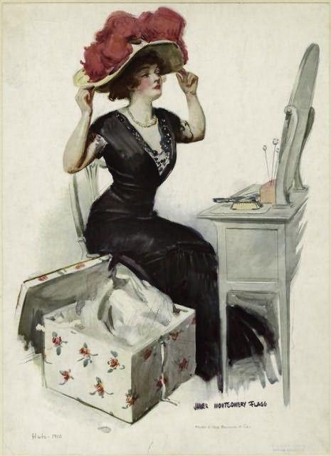 1910ca. Женщина, сидящая за туалетным столиком примеряет шляпу