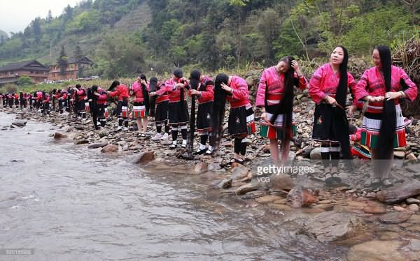 Yao women comb hair during the Long Hair Festival at Longji Huangluo Yao Village on April 9, 2016 in Guilin, Guangxi Zhuang Autonomous Region of China. Yao people celebrated the first Long Hair Festival during the Double Third Festival on March 3 of the Chinese calendar.