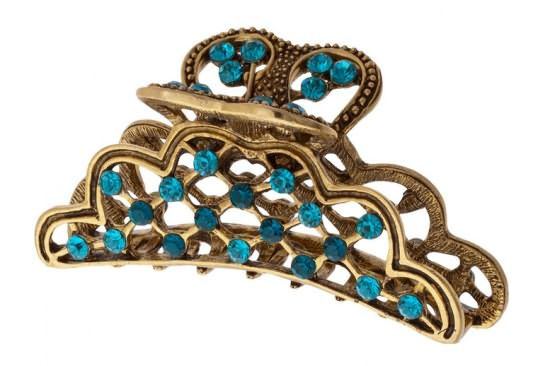 Фото декоративного металлического краба, украшенного камнями